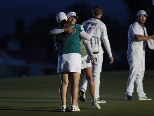 Inbee Park and Pernilla Lindberg embrace after they