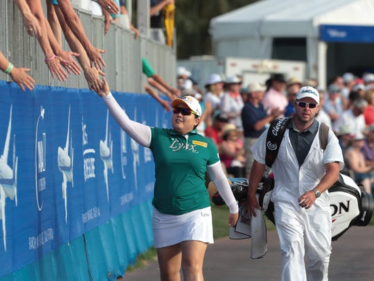 Inbee Park high fives fans on her way to the green of the 18th hole of the ANA Inspiration, Sunday, April 1, 2018.
