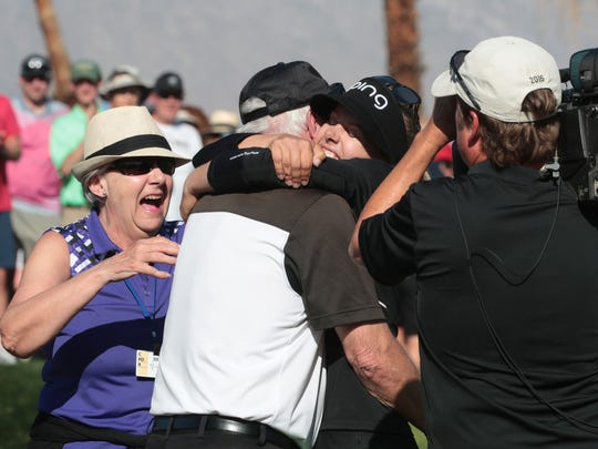 Pernilla Lindberg embraces her parents after winning the ANA Inspiration in an eight round playoff, Rancho Mirage, Calif., Monday, April 2, 2018.
