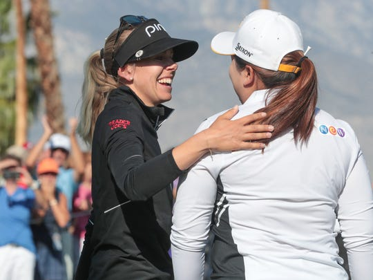 Pernilla Lindberg embraces Inbee Park after winning the ANA Inspiration in an eight round playoff, Rancho Mirage, Calif., Monday, April 2, 2018.