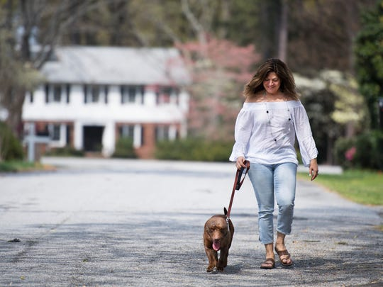 Fran Alexay Rizzo walks Legend through her neighborhood on Tuesday, April 3, 2018.