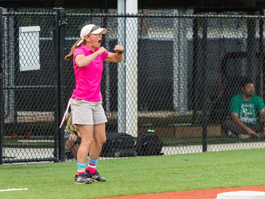 Cougars coach Andrea Waguespack reacts to a base hit