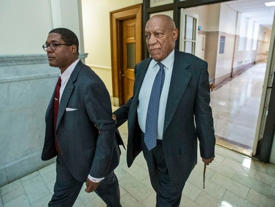 Bill Cosby holds onto his spokesman and escort, Andrew