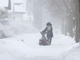A resident plows snow on her sidewalk Tuesday in Wausau,