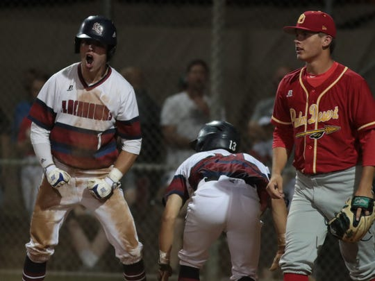Trenton Schwanke reacts after scoring a run behind his teammate Sakemi Sato, La Quinta, Calif., April 3, 2018.
