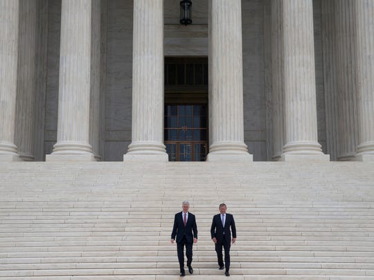 Justice Neil Gorsuch descends the steps of the Supreme Court with Chief Justice John Roberts after his official investiture ceremony in June.