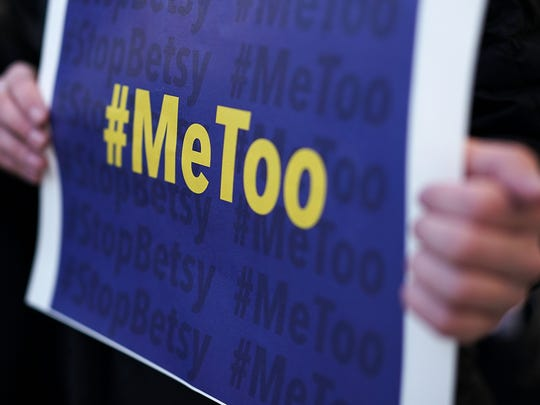 """WASHINGTON, DC - JANUARY 25:  An activist holds a #MeToo sign during a news conference on a Title IX lawsuit outside the Department of Education January 25, 2018 in Washington, DC. Anti-sexual harassment groups held a news conference to announce a """"landmark lawsuit against the Trump Administration over Title IX"""" and the """"unconstitutional Title IX policy harming student survivors of sexual violence and harassment."""""""