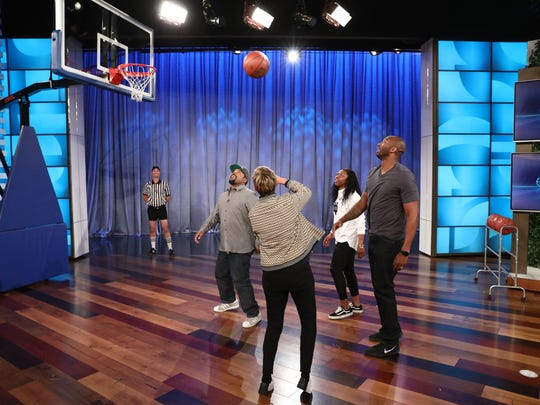 "In this photo released by Warner Bros., a taping of ""The Ellen DeGeneres Show"" is seen at the Warner Bros. lot in Burbank, Calif. Arike Ogunbowale and Ellen DeGeneres challenge rapper/actor Ice Cube and former NBA superstar Kobe Bryant in a game of 2-on-2."