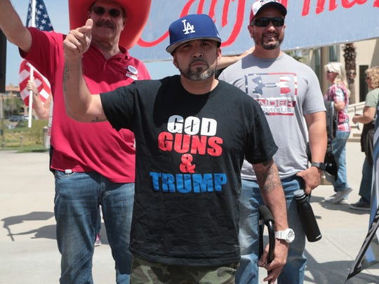 Louie Demeo stands with a group of counter-protesters outside of the Unite Inland Empire Conservative Conference in Riverside, Calif., Sunday, April 8, 2018.