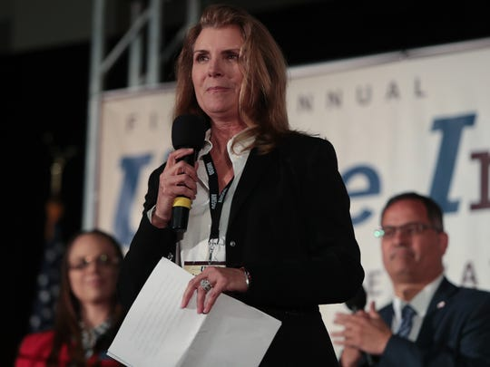 Congressional candidate Kimberlin Brown-Pelzer speaks at the Unite Inland Empire Conservative Conference in Riverside, Calif., Sunday, April 8, 2018.