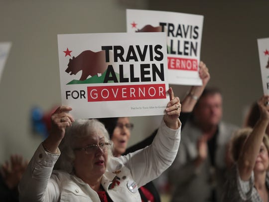 Travis Allen supporters react to the gubernatorial candidate's speech at Unite Inland Empire Conservative Conference in Riverside, Calif., Sunday, April 8, 2018.