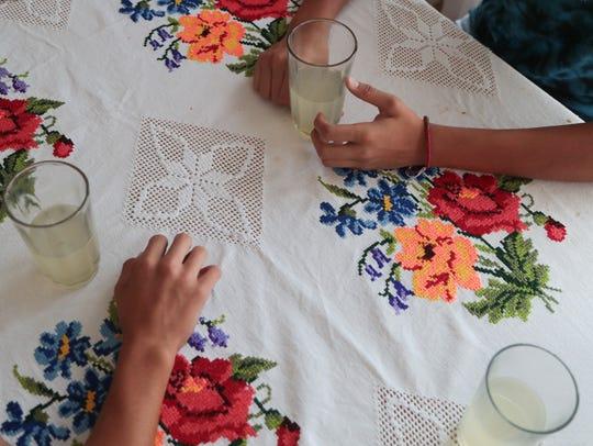 Josue and Joel Duarte drink lemonade at their dining
