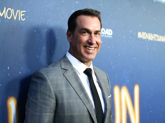 """Rob Riggle hosts a podcast called """"Riggle's Picks"""" with Sarah Tiana, which touches on topics including sports and pop culture. The former U.S. Marine also starred in the movie """"Midnight Sun"""" earlier this year opposite Bella Thorne and was seen on Fox Sport's Sunday NFL coverage."""