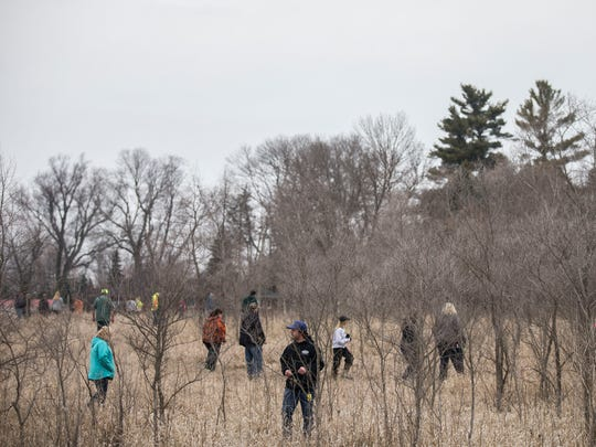 A team of volunteers searches a wooded area several miles outside of La Porte City for clues to the disappearance of Jake Wilson, who has been missing for four days, on Wednesday, April 11, 2018, in Black Hawk County. Over the past three day hundreds of volunteers have participated in the search.