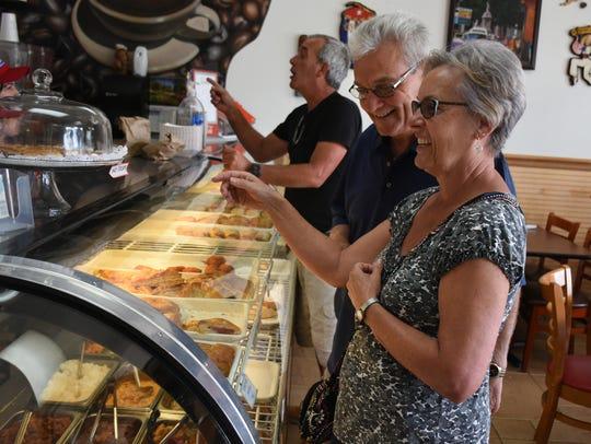 Patrons enjoy food and conversation. Floridita Cuban