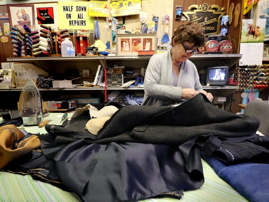 Sue Pappalardo works on customers' tayloring jobs at