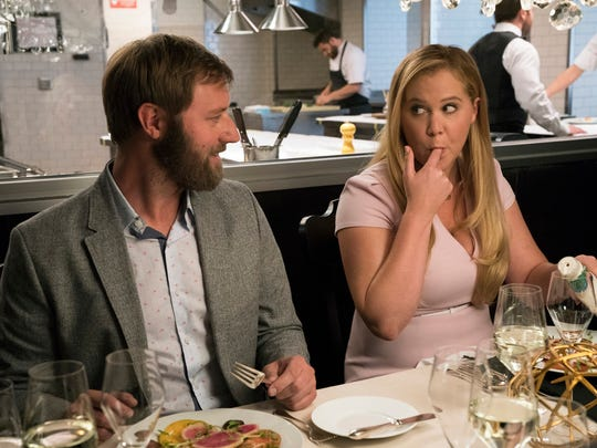 Ethan (Rory Scovel) is impressed by Renee (Amy Schumer)