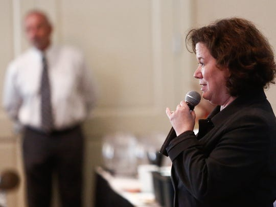 Bonita Springs City Attorney Audrey Vance addresses the crowd during a public forum at Worthington Country Club on Nov. 2, 2015, about a proposed high school site near the Hunters Ridge, Worthington, and Quail West communities in Bonita Springs.