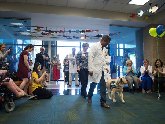 Dr. Arun Singh introduces King, a new therapy dog at GHS Children's Hospital, on Thursday, April 19, 2018.