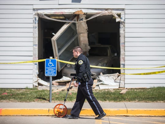 A Des Moines police officer investigates the scene