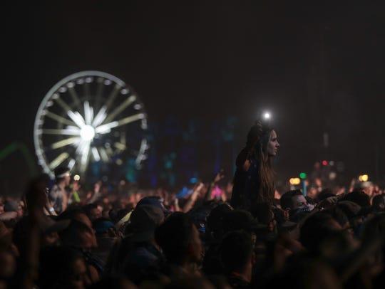 April 22, 2018; Indio, CA, USA; Festival goers listen