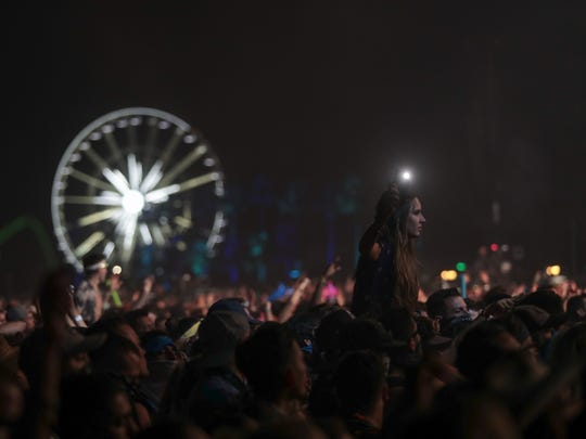 April 22, 2018; Indio, CA, USA; Festival goers listen