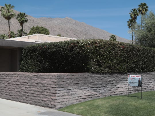 A for sale sign is seen outside of a home in Palm Springs,