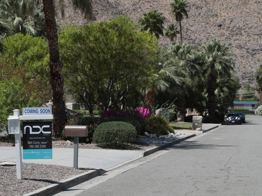 A for sale sign is seen outside of a home in Palm Springs, Calif., April 23, 2018.