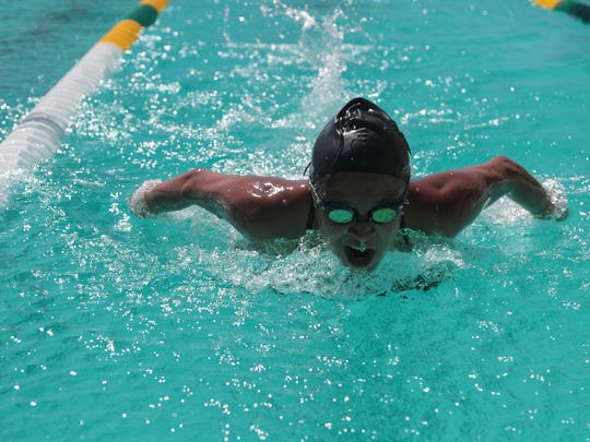 Olivia Garcia swims during practice at Coachella Valley High School. As a first-year student, Olivia has already broken five of her school's varsity records, Thermal, Calif., April 23, 2018.