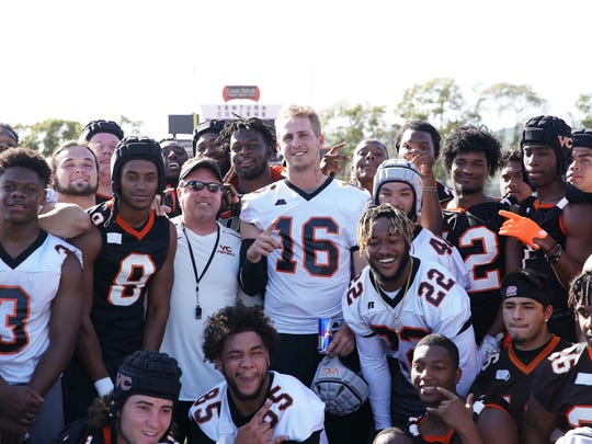 Los Angeles Rams quarterback Jared Goff poses with the Ventura College football team after pulling off his spring practice prank on April 9.