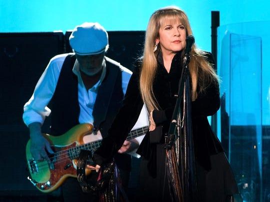 John McVie and Stevie Nicks of Fleetwood Mac perform