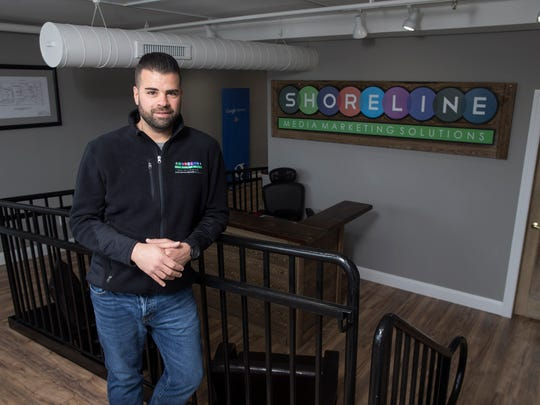 Joe Sernio, owner and CEO of Shoreline Media Marketing Solutions, stands in the companies new office space on Lake Avenue. 