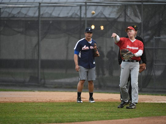 FILE PHOTO - Rep. Mike Conaway (R-TX) tosses a ball to third base during the first Republican Team practice for the Congressional Baseball Game for Charity at Simpson Field in Alexandria, VA, since the 2017 shooting that seriously injured Rep. Steve Scalise (R-LA) on the same field.
