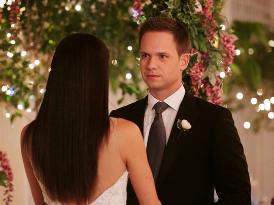 Patrick J. Adams as Mike Ross and Meghan Markle as