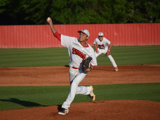 Tioga senior pitcher Dylan Coburn throws a pitch in the fifth inning of the Indians' first-round baseball playoff game against Westgate.