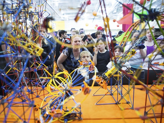 Maureen and Liam Foster of Clay, NY, look at amusement rides made out of K'Nex during Imagine RIT 2015.