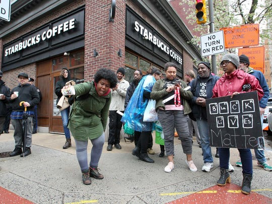 Protester Aurica Hurst of West Philadelphia pours out