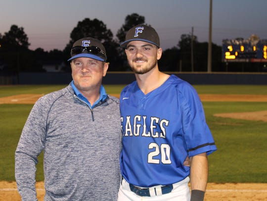Kip West with son Gage West, a senior at Faulkner University.