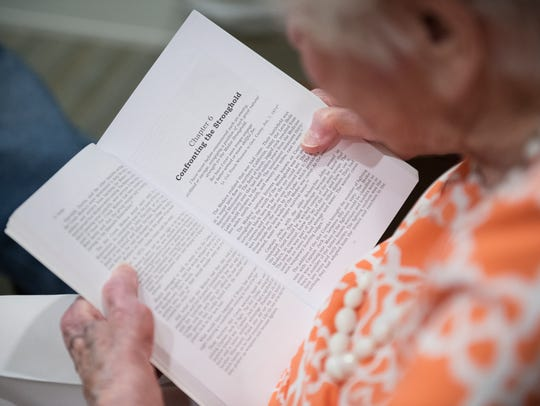 Annamarie Burts, 101, reads to fellow Rolling Green
