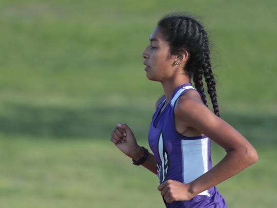 Nyah Chavez leads the field to her win of the girls 1600 meter run at the Desert Valley League track and field championships, Palm Desert, Calif,. May 2, 2018.