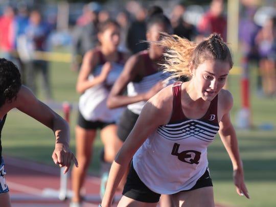 Isabella Fakehany wins the girls 100 meter hurdles