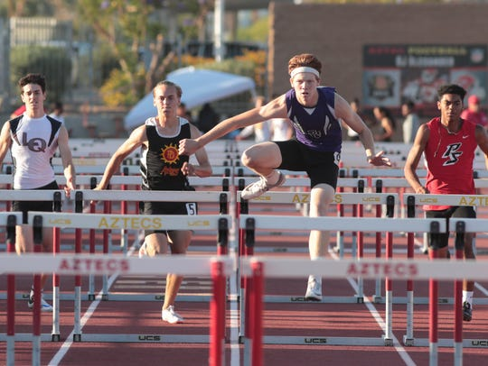 Dylan Francis wins the boys 110 meter hurdles at the