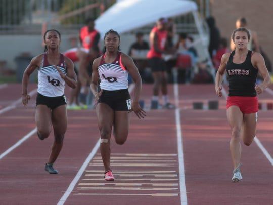Hailey Murdica, right, wins the girls 100 meter dash