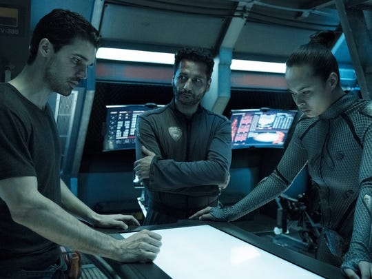 "Steven Strait as Earther James Holden, Cas Anvar as Alex Kamal and Frankie Adams as Bobbie Draper on the space opera, ""The Expanse."""