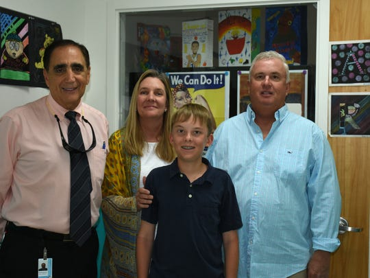 Proud principal and parents Ð George Abounader, Gigi and Rob Garraty with Ryan. Marco Island Charter Middle School seventh grader Ryan Garraty qualified for the USA Sailing Team in trials held April in Miami.