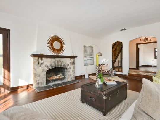 Tudor charm and architectural detail are evident throughout