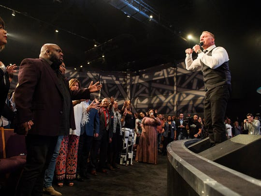 Pastor Ron Carpenter welcomes Pastor John Gray as the new leader of Relentless Church during a farewell service on Sunday, May 6, 2018.