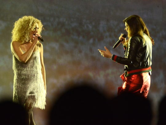 Singers Kimberly Schlapman and Karen Fairchild of Little Big Town perform with the band at Saturday's sold-out  Germain Arena show.