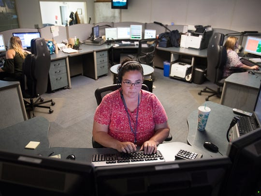 Mary Brown takes 911 calls in the call center on Tuesday, May 15, 2018.