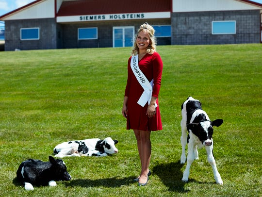 Standing in front of her family's dairy operation in